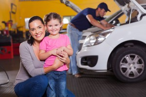 Mother and daughter in garage